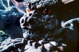 A portrait of a black, scaly, golden-eyed, horned, and very artificial looking dragon: North Korea's 'Pulgasari'.