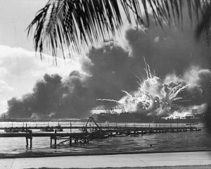 Black and white photo of the USS Shaw being destroyed at the 1941 Japanese attack on Pearl Harbor