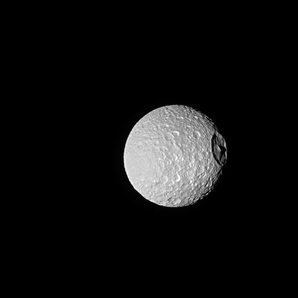 Saturn's Moon Mimas and It's Mountain