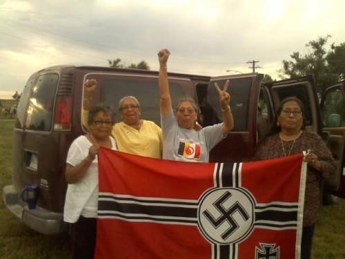 Lakota and Dakota grandmothers captured the Nazi flag hanging in Leith, ND and burned it. Warriors!