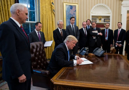 Trump & a gaggle of old white men sign a ban on giving federal family planning funding to international health groups that provide abortion care