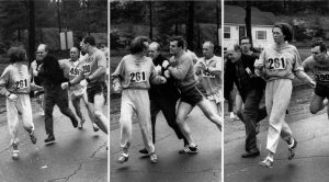 Image courtesy Newsweek. A woman, listed only as K. Switzer of Syracuse, found herself about to be thrown out of the normally all-male Boston Marathon when a husky companion, Thomas Miller of Syracuse, threw a block that tossed a race official out of the running instead, April 19, 1967 in Hopkinton, Mass.(AP PHOTO)