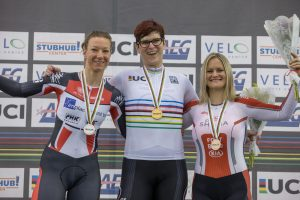 Rachel McKinnon sharing a podium with two other women athletes. Photo by Mike Gladu.