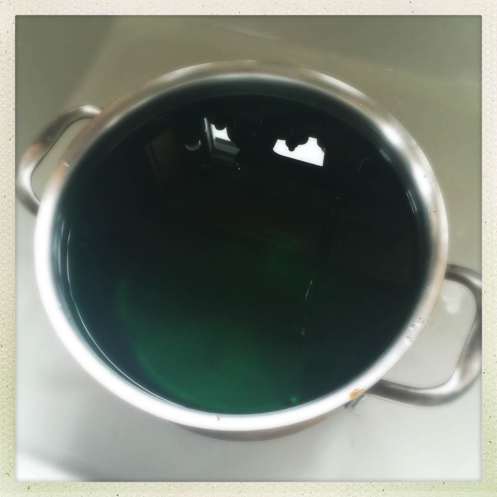cool water with green food dye, standing by