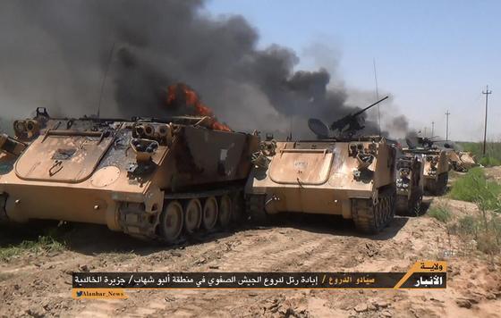Abandoned M113s in Anbar Ambush