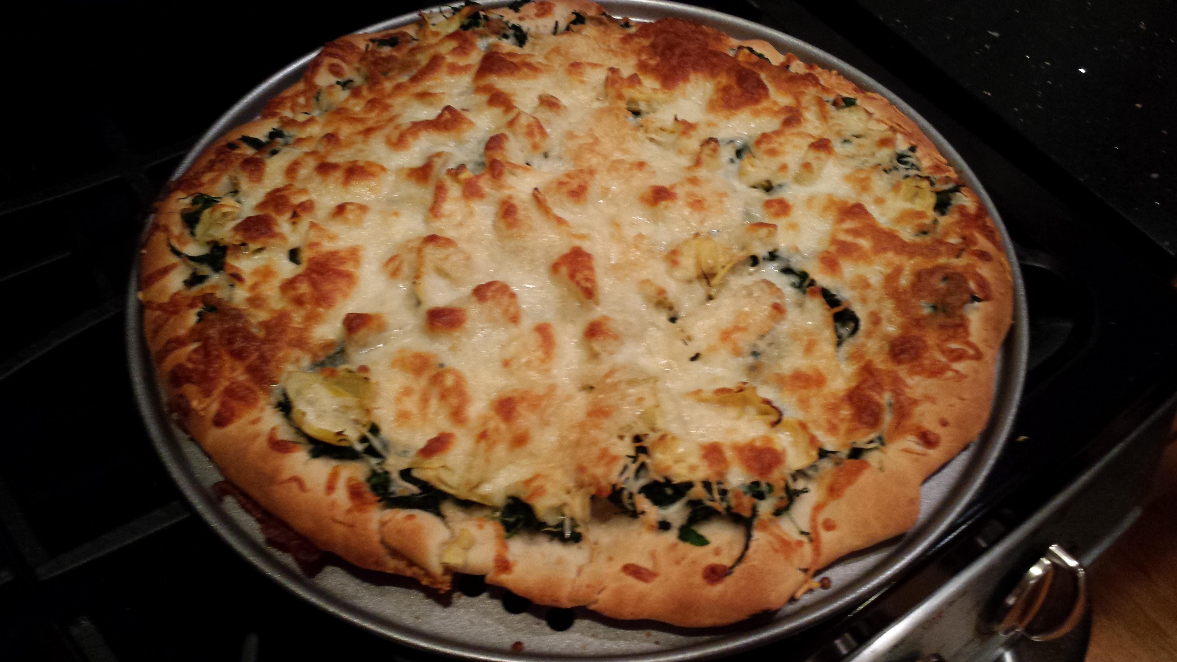 Pizza by commentariat member Celeste: Spinach, artichokes, mozarella, parmesan, forgot the garlic