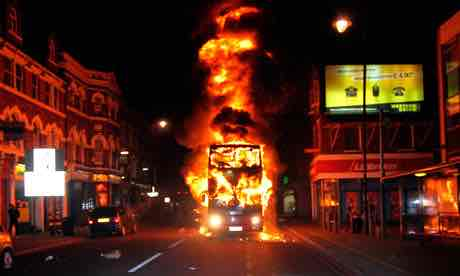 A Bus Burning in Tottenham, twitter via the [Guardian]