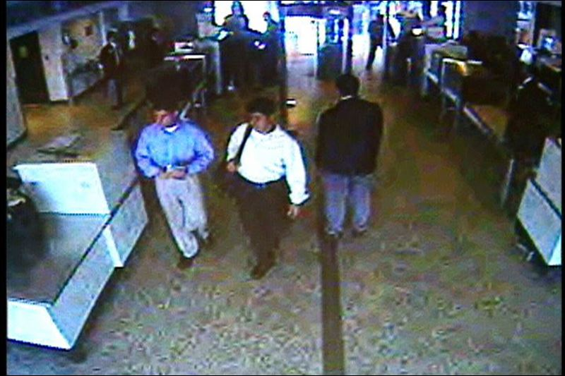 A couple of yuppies going through security 9/11