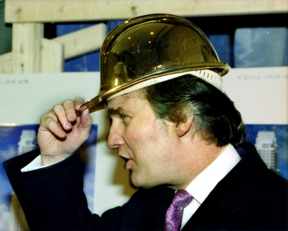 What is it about authoritarians and big hats?