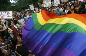"Gay rights activists display a rainbow flag during ""Queer Pride March"" in New Delhi"