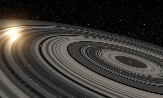 Artist's conception of the extrasolar ring system circling the young giant planet or brown dwarf J1407b. The rings are shown eclipsing the young sun-like star J1407, as they would have appeared in early 2007. Credit: Ron Miller